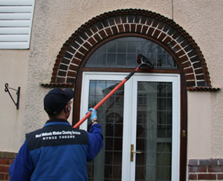 West Midlands Window Cleaning Services cleaning a front door