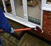 Cleaning doorstep of PVCu door - windows and frames get cleaned at the same time
