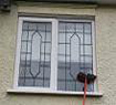 Cleaning leaded window - the soft bristles of the brush clean round the lead removing previous detergents and debris